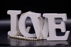 love letters and pearl necklace Royalty Free Stock Photos