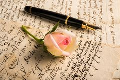 Love letters. Rose and fountain pen on a letters royalty free stock images