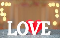 Love letters sign with blur lights Stock Photos