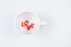 LOVE Letters in White Coffee Cup. (Top View) for Valentines day Royalty Free Stock Image