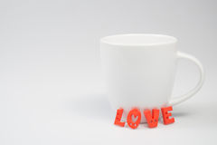 LOVE Letters with White Coffee Cup. For Valentines day Royalty Free Stock Photography