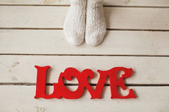 Love letters on the wooden floor with woman legs Royalty Free Stock Photo