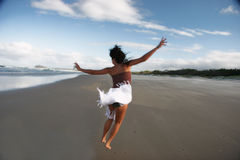 Love Life. Girl jumping on the beach Stock Image