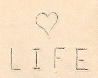 Love life lettering drawn on sand Stock Image
