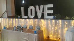 LOVE in Lights: Wedding Decorations royalty free stock photo