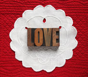 Love on linen doily Royalty Free Stock Images