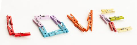 Love from little colorful office clothespins Stock Photos