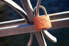Love lock attached to a metal balustrade Royalty Free Stock Photography