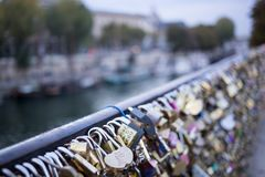 Love lock on a bridge in Paris, France Eternity connection Love symbol. Stock Photos