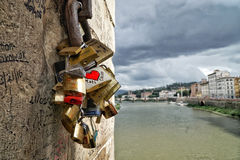 Love lock of couples by Arno river in Florence, Italy. Stock Image