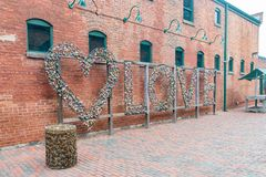 Love lock wall in The Distillery Historic District. Toronto, OCT 5: Love lock wall in The Distillery Historic District on OCT 5, 2018 at Tornoto, Canada stock images
