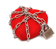 Love locked heart shape with chains Stock Photos