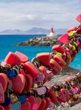 Love Locks at Puerto del Carmen in Lanzarote, Canary islands, selective focus, lighthouse in the distance, blurred background royalty free stock images
