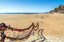 Love locks, beach and ocean in Puerto del Carmen boardwalk, Lanzarote Royalty Free Stock Photos