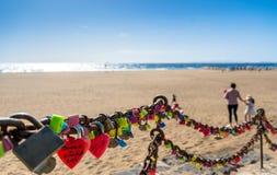 Love locks, beach and ocean in Puerto del Carmen boardwalk, Lanzarote Royalty Free Stock Images