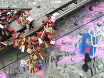 The love locks being fullfilled attached on hohenzollern bridge Stock Images
