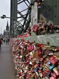 The love locks being fullfilled attached on hohenzollern bridge Stock Photo