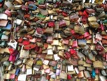 The love locks being fullfilled on hohenzollern bridge Royalty Free Stock Photo