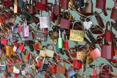 Love Locks on a Bridge Crossing the Salzach River in Salzburg stock images