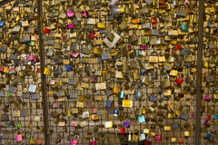 Love locks from a bridge in Italy representing secure friendship and romance Royalty Free Stock Photos