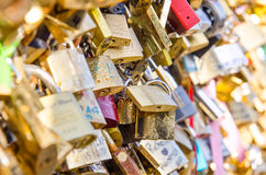 Love locks on the bridge. Pont des Arts across river Seine in Paris, France Royalty Free Stock Photo