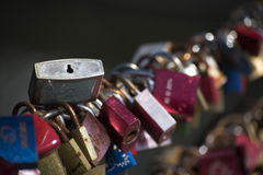 Love locks on a bridge railing Royalty Free Stock Images