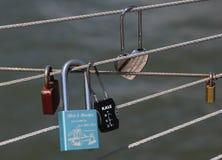 Love locks at the Brooklyn Bridge Park in New York. BROOKLYN, NEW YORK - AUGUST 13, 2017: Love locks at the Brooklyn Bridge Park in Brooklyn, New York. Ritual of Royalty Free Stock Photos
