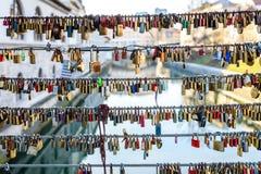 Love locks on the butchers bridge in Ljubljana Slovenia. Bridge full of colorful love padlocks hanging from fence with names written on it. Mesarski most Stock Photo