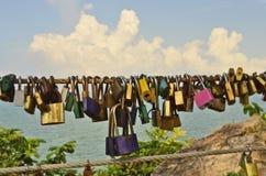 Love locks of couples on sling racks Stock Photo