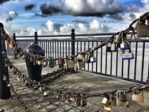 Love locks on the dock Stock Photos