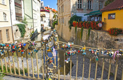 Love locks hang from a bridge over the river Certovka in Prague. Stock Image