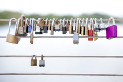 Love Locks Hanging from a Cable Railing Stock Photos