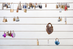 Love Locks Hanging from a Cable Railing Stock Photography