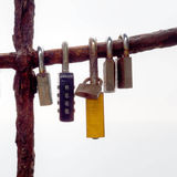 Love locks hanging on rusty bar. Backlit. Stock Photo