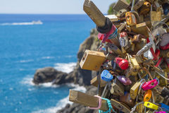 Love locks on the Ligurian Coast. In National Park of Cinque Terre, Riomaggiore,Italy Royalty Free Stock Image