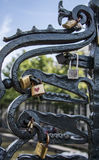 Love locks on the Magere brug (skinny bridge) over the river Amstel in Amsterdam. Close up image of love locks or love padlocks which romantic couples lock on Stock Photography