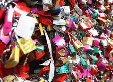 Love locks. Many colorful locks on a gate. The lovers lock the locks on a gate and they throw away the key to symbolize an unbreakable love stock photos