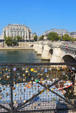 Love locks near the Pont Neuf in Paris, France vertical Royalty Free Stock Photos