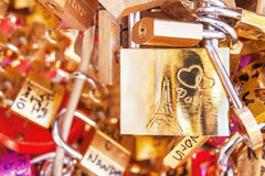 Love locks (padlocks) attached to the bridge in Paris. France. Stock Photos