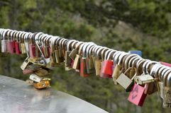 Love locks. Padlocks hanging on a railing of an outlook tower Stock Images