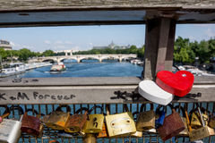 Love locks on Paris bridge Pont de Arts. Love locks on bridge in Paris with view to River Seine and bridges Stock Image