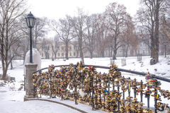 Love locks on a park bridge fence. Many love locks on a small park bridge fence Stock Photography