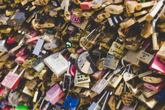 Love locks placed by tourists on the Pont des Arts on the river Seine. Royalty Free Stock Photos
