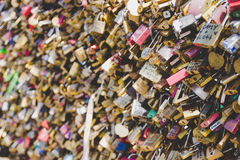 Love locks placed by tourists on the Pont des Arts on the river Seine. Stock Photo