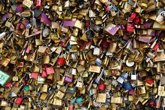 Love locks. The small locks are fastened to a bridge in Paris Royalty Free Stock Photography