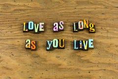 Love long live life enjoy letterpress. Typography enjoyment happiness happy smile smiling emotion expression help helping kindness joy trust relationship stock photo