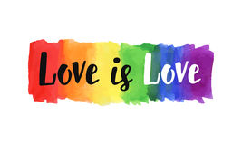 Love is love. Hand lettering written on a watercolor rainbow spectrum pride flag, isolated on white. LGBT rights concept. Modern poster, cards design Royalty Free Stock Photography