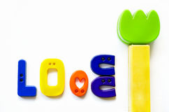 Love made from  plastic buttons and tulip plastic flower Stock Photos