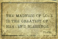 Love madness Plato. The madness of love is the greatest - ancient Greek philosopher Plato quote printed on grunge vintage cardboard Stock Image