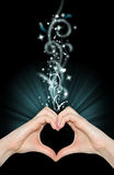 Love magic, hands of heart shape. On black Stock Photography